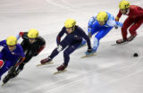 Anton Apolo Ohno (center, #254) fights through a corner while skating in the middle of the pack at...