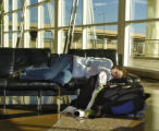 Emily Faivre (cq) rests in the Main Terminal at DIA Sunday afternoon February 12, 2006. Faivre was...