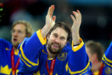 Sweden's Peter Forsberg (#21) celebrates with teammates after receiving his gold medal for their...