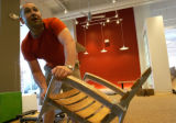 (DENVER, Colo., July 1, 2004)  Matt Wilkerson, Area Manager of Design Within Reach, takes a chair...