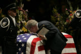 Thomas Jensen kisses the coffin of his son police officer Jared Jensen.  He spoke about his son at...