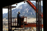 BOULDER., Colo., Feb. 28, 2006) A construction worker, moves his crane as workers make the 29th...