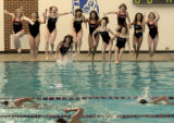 Swimmers for the 2006 All-Colorado girls swimming team jump into the Cherry Creek High School...