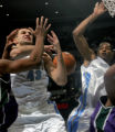 Denver Nugget Linas Kleiza, left, gets the ball knocked out of his hand as teammate Marcus Camby,...