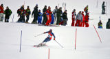 Course workers watch as U.S. skiier Bode Miller (#32) passes by them during the Men's Combined...