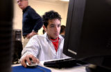 (DENVER., Colo., Feb. 14, 2006) Tenth grader, Robert Casias (cq) works on a test on a computer...