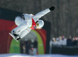 Hannah Teter does a grab as she flies out of the pipe for her first run in the women's half-pipe...