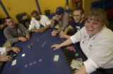 Dealer Rhonda Donohue, right, jokes with players of Texas Hold 'Em at Mi Palacio in Thornton...