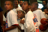 (DENVER, CO.,  JULY 1, 2004) Children line up to meet former Denver Nugget and George Washington...