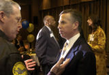 Marc Holtzmanm, foreground right, talks with retired USAF Brigadier General Steve Ritchie after...