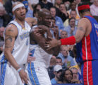Denver Nugget forward Kenyon Martin, left, and Detroit Piston Rasheed Wallace, right, hold back...