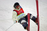 Finnish Moguls skiier Janne Lahtela tries to gain control of a landing by riding it out on the...