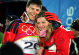 Croatian skiiers Janica (right) and Ivica Kostelic hug after Ivica won a silver medal in the Men's...