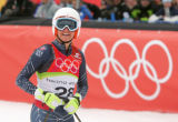Julia Mancuso, of the USA, smiles as she looks up at her time in the women's downhill at San...