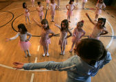 JPM627 David Taylor Ballet Company dancer Lesley Henry, bottom, leads a group of about 30...