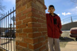 Junior Saucedo (cq), 10, stands on the sidewalk close to where he was hit by a car last April...