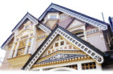 The eaves of this Bicroisan in northwest Denver incorporate seven colors, including warm white,...
