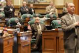 Colorado State Representative, Joe Stengel (R) HD38 remains seated during the singing of the...