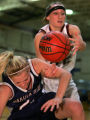 Dakota Ridge's #21 Lindsi Holm, left, and Horizon's #25 Hannah Taomi struggle for control of a...