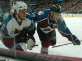 (Denver, Colo., April 26, 2004)  San Jose Sharks' 22, SCOTT Hannan and Colorado Avalanche's #19,...