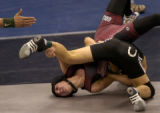 Brooke Sauer of Golden (in maroon) wrestles against Pueblo South's Jeremy Aguero in the 4A 103...