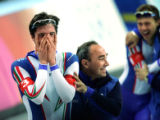 Team Italia member Enricoo Fabris (left) celebrates with one of his coaches after winning the gold...