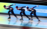 The U.S. Women's Team Pursuit Speed Skating team races around a corner during a finals matchup...