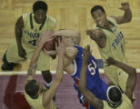 Cherry Creek's Christian Pingree, #50, middle, is mauled by Aurora Central defenders Kofi Woahene...