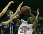 Denver East's Demetrius Thornton, right, goes up for a shot being defended by Grandview's Brandon...