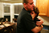 Sgt. Brad Bulechek, cq, comforts his roommate's mother, Sharon Alexander, cq, after her son...