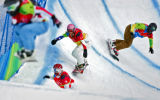 U.S. snowboarder Lindsey Jacobellis (bottom left, #3) runs in second place as the pack enters a...