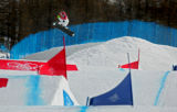 U.S. snowboarder Lindsey Jacobellis pulls a method air off one of the final jumps on the course...