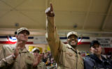 Sergeant Leroy Scott, cq, center, a member of 2/3 Armored Cavalry Regiment, acknowledges fellow...