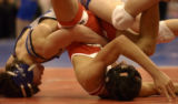 Pueblo Centenniel's Joe King, left, and Broomfield's Cory Casady go upside-down in Friday's state...
