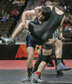 Jordan Weber of Legacy High School, left, lifts Pomona' Willie McClure, right, in 171 lb bout in...