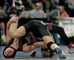 Brooke Sauer, left,  a senior at out of Golden High School wrestles Jeremy Aguero, right,  of...