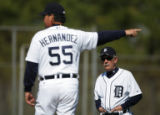 Detroit Tigers new manager Jim Leyland (10), right, watches new pitching coach Chuck Hernandez...