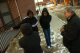 Quigg Newton Homes residents Christina Maes, back to camera, left, Taylor Speights, middle left,...