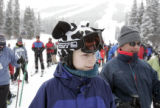 A young snow boarder with a cow cover on his helmet waitsw in line on the Prospector chair lift...