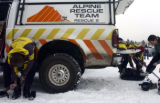 Alpine Rescue Team members Bryan Osburn, left, and Melissa Archey get their gear on at the...