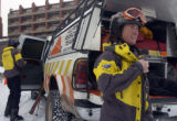 Alpine Rescue Team members Melissa Archey, foreground, and Bryan Osburn get their gear on at the...