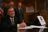 Governor Bill Owens becomes the 100,000th Colorado citizen  to signthe First Class Education for...