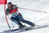 Erik Schlopy, of the USA, skis past a gate on the first run of the men's giant slalom in Sestriere...