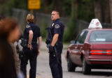Denver, Colo., photo taken June 17, 2004- Glendale police hold a perimeter around an apartment...