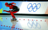 Japanese speed skater Yusuke Imai waits for the starter's pistol to fire at the starting line as...