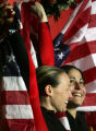 Pilot Shauna Rohbock, left, and brakeman Valerie Fleming, right, hold U.S. flags and celebrate...