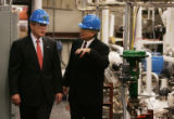 JPM596 National Renewable Energy Laboratory director Dan Arvizu, right, shows President George W....