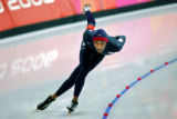 U.S. speed skater Shani Davis rounds a corner on his way to a silver medal during the Men's 1500...