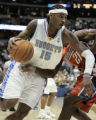 Carmelo Anthony drives against Bernard Robinson  and is fouled in the second period as the Denver...
