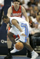 Nuggets Greg Buckner fights for the ball against Jake Voskuhl in the 4th period as the Denver...